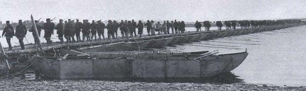Japanese troops crossing the Yalu on a pontoon bridge.