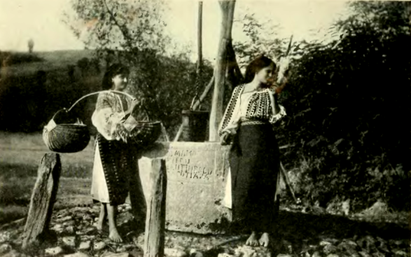Romanian peasants near a well, 1921.